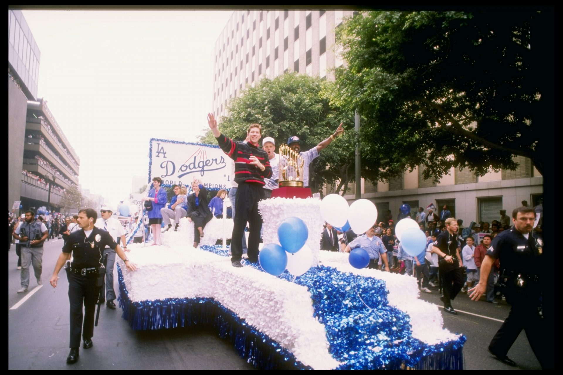 Pitcher and World Series MVP Orel Hershiser waves in a victory parade after the Dodgers win the 1988 World Series