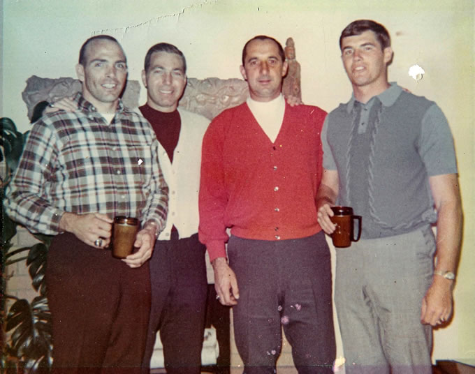 Members of the Packers celebrated Christmas together in 1965. From left: Carroll Dale, Bart Starr, Zeke Bratkowski and Bob Long.